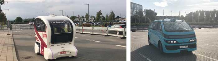 様々な自動運転車両がデモ走行する会場内(左:イギリスのPathfinder、右:フランスのNavya社のAutonom Cab)...ザ・トラック