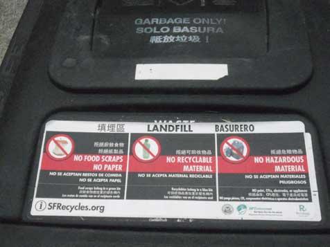 黒色のビンは「埋立品、青=リサイクル品(紙・樹脂類・ガラス・金属・繊維製品)」用。中国語・英語・スペイン語の3カ国語で表示...ザ・トラック